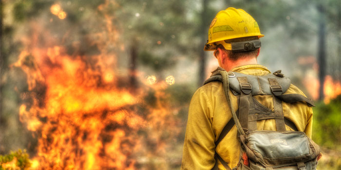 A firefighter prepares to battle a ground fire